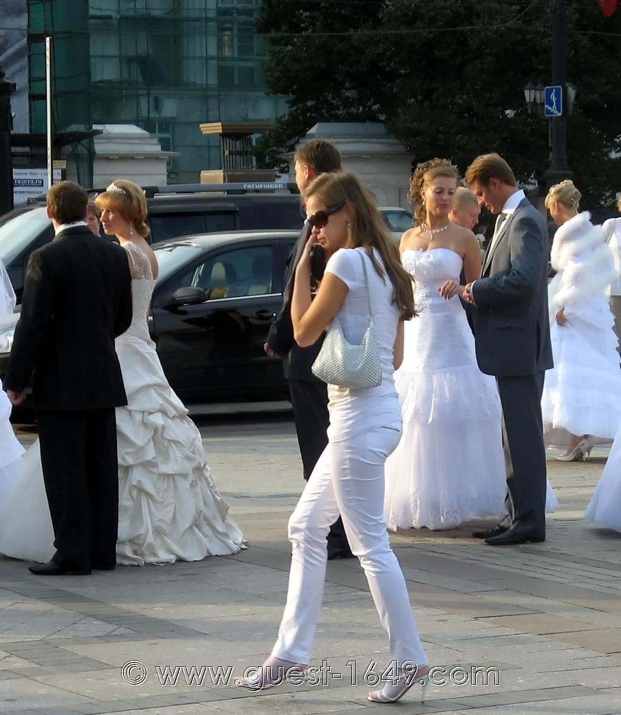 Slim brunette in white suit