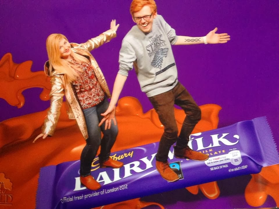 Both of us standing on top of a green screen bar of dairy milk chocolate riding a chocolate wave