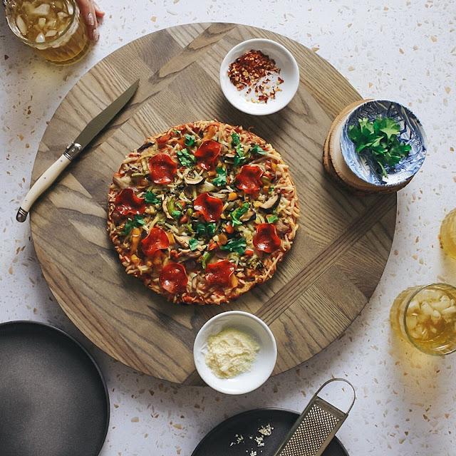 PIZZA ON ASH BOARD