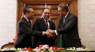 China pledged to help Afghanistan and Pakistan overcome longstanding suspicions, as officials from the three nations met on Saturday in the latest round of diplomacy aimed at opening talks with the Taliban to end the Afghan war.