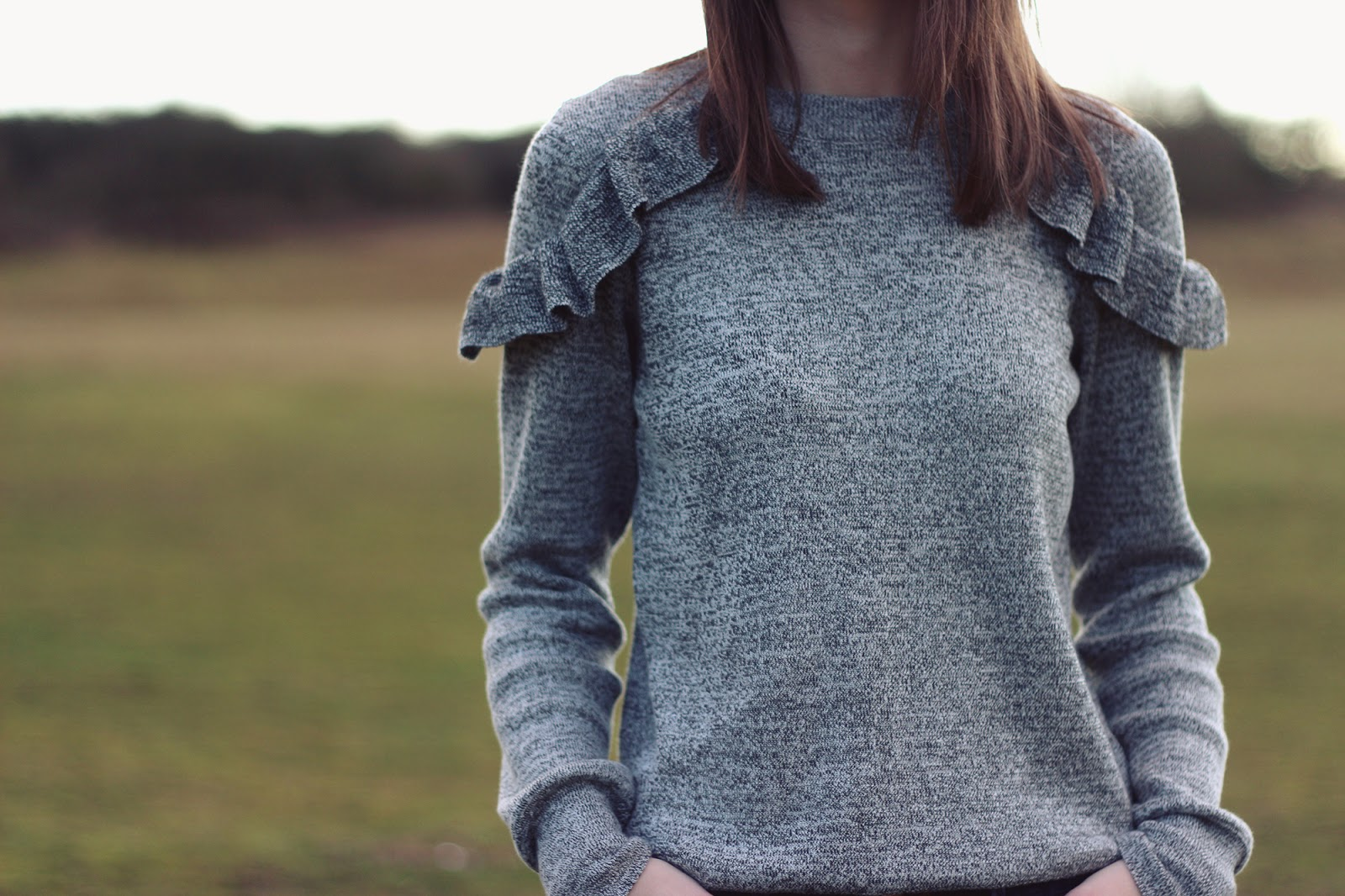 An image showing a jumper with ruffles
