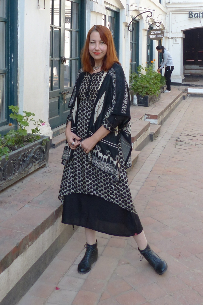 Layered dress with poncho over it