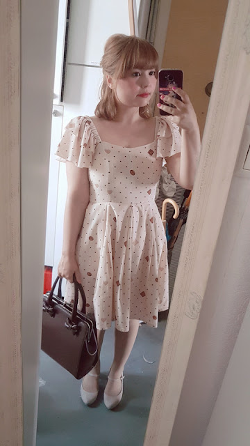 mirror selfie with auris wearing a cookie dress by lady sloth and a brown bag