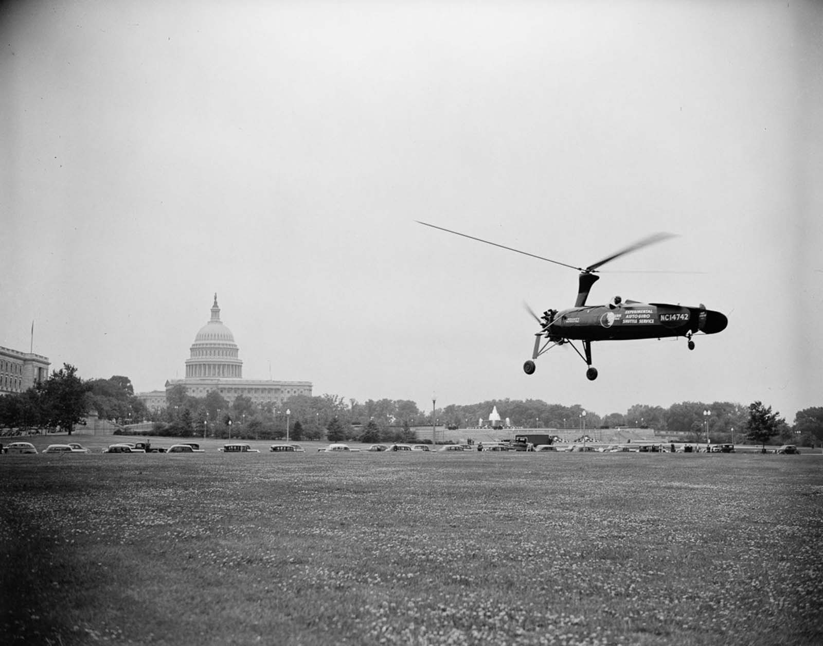 An autogyro lands on the grounds of the Washington, D.C. post office to demonstrate the feasibility of using autogyros to deliver mail. 1938.