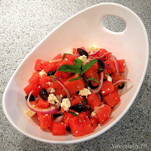 Watermelon salad in a white bowl