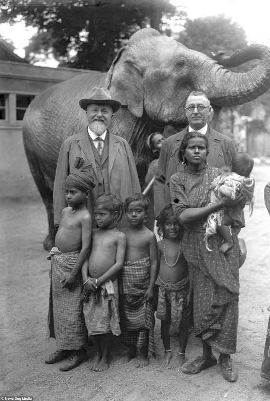 German zoologist Professor Lutz Heck is pictured (left) with an elephant and a family he brought to the Berlin Zoo, in Germany in 1931.