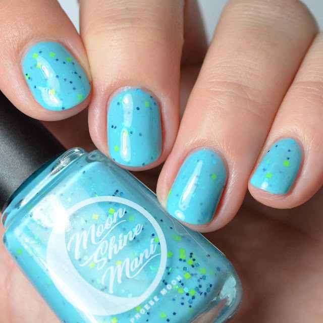 blue crelly nail polish with green glitter