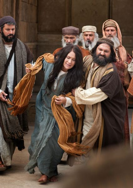 One day Jesus was teaching crowds of people in the temple, and religious leaders brought a woman caught in the act of adultery to him.
