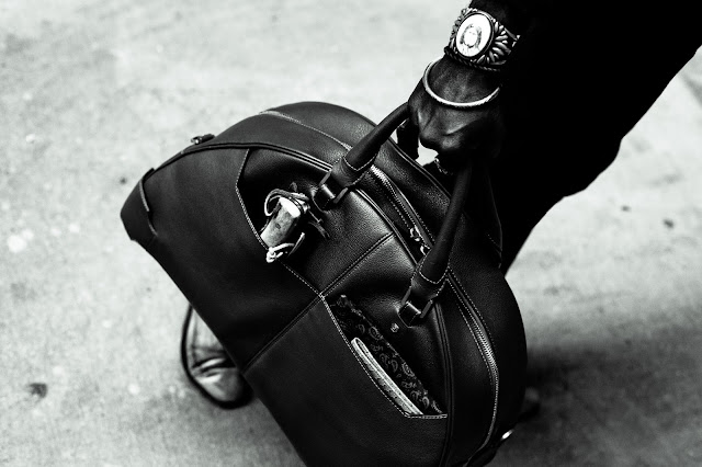 man with packed arch bowling bag