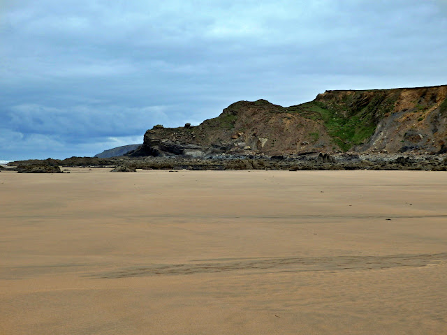 Lots of sand on the beach at Northcott Mouth, Cornwall when the tide is out