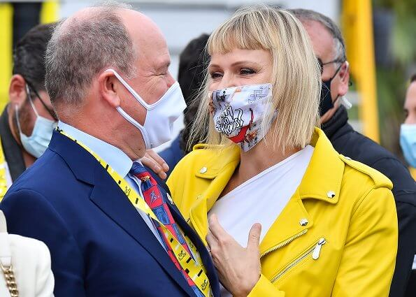 Princess Charlene wore a leather biker full color yellow jacket by Philipp Plein, and white blouse and trousers by Roland Mouret