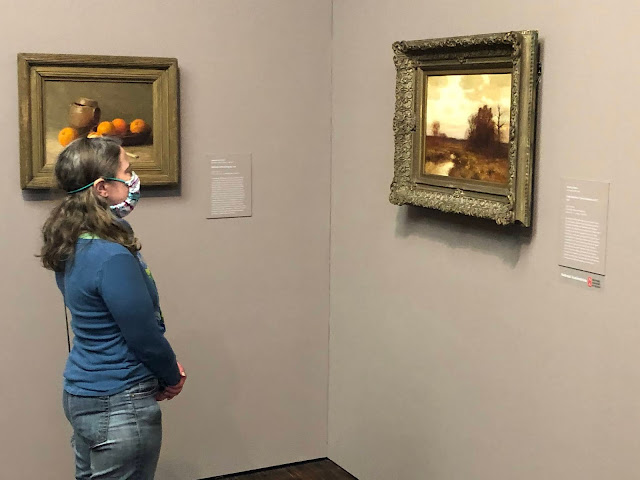 Here I am looking at one of my favorites at Figge Art Museum: Late Autumn East Hampton, NY by Bruce Crane. On the other wall you will see Still Life with Oranges by Jeannette Scott.