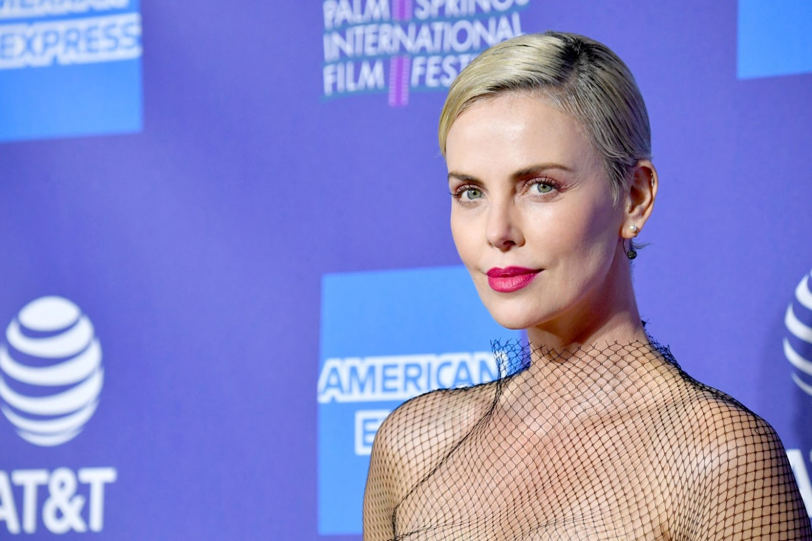 Charlize Theron wears tweed fishnet frock to accept award at Palm Springs Festival