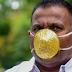 Pria India Ini Pakai Masker Berlapis Emas