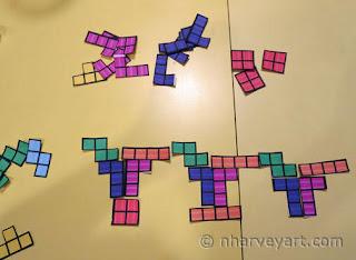 Arranging paper Tetris pieces 1