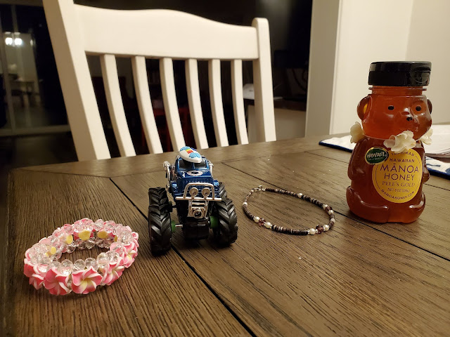 souvenirs - jewellery, toy car and honey