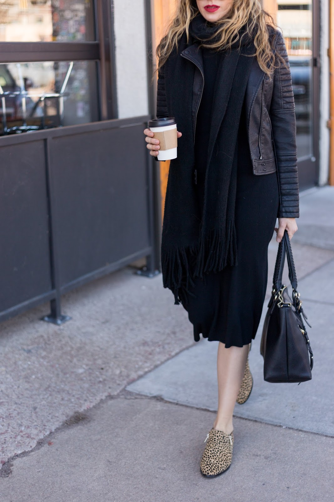 leather jacket with sweater dress and fringe scarf