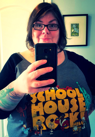 image of me standing in a mirror, wearing a Schoolhouse Rock! t-shirt