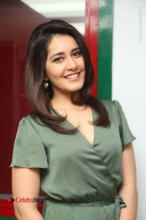 Actress Raashi Khanna Stills in Green Short Dress at Mirchi 95 Suno Aur Mercedes Jeeto Contest  0110.JPG