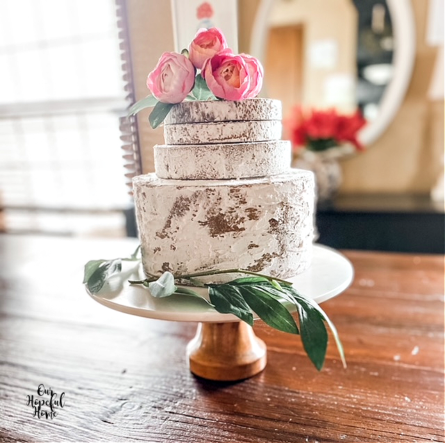 four tier fake naked cake marble stand flowers
