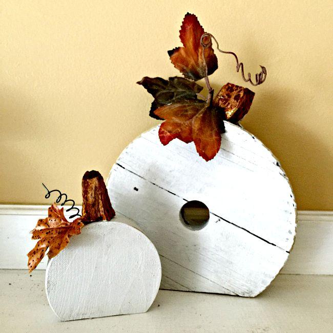 two repurposed wooden pumpkins