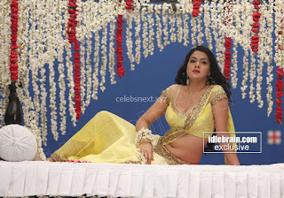 Sakshi Chodary in Yellow Transparent Sareei Choli Spicy Pics 28 .xyz.jpg
