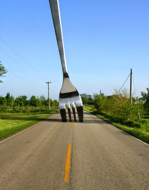 Picture of a giant fork superimposed onto an empty road - visual joke