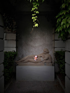 photographs of a statue in a cemetery on a rainy day by andreas warren matti