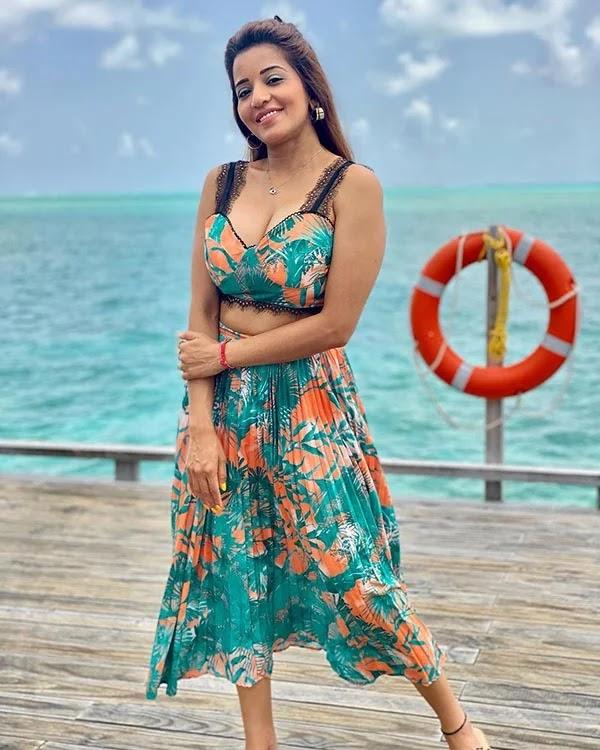 Monalisa enjoying a vacation in bikini and cleavage baring beach wear