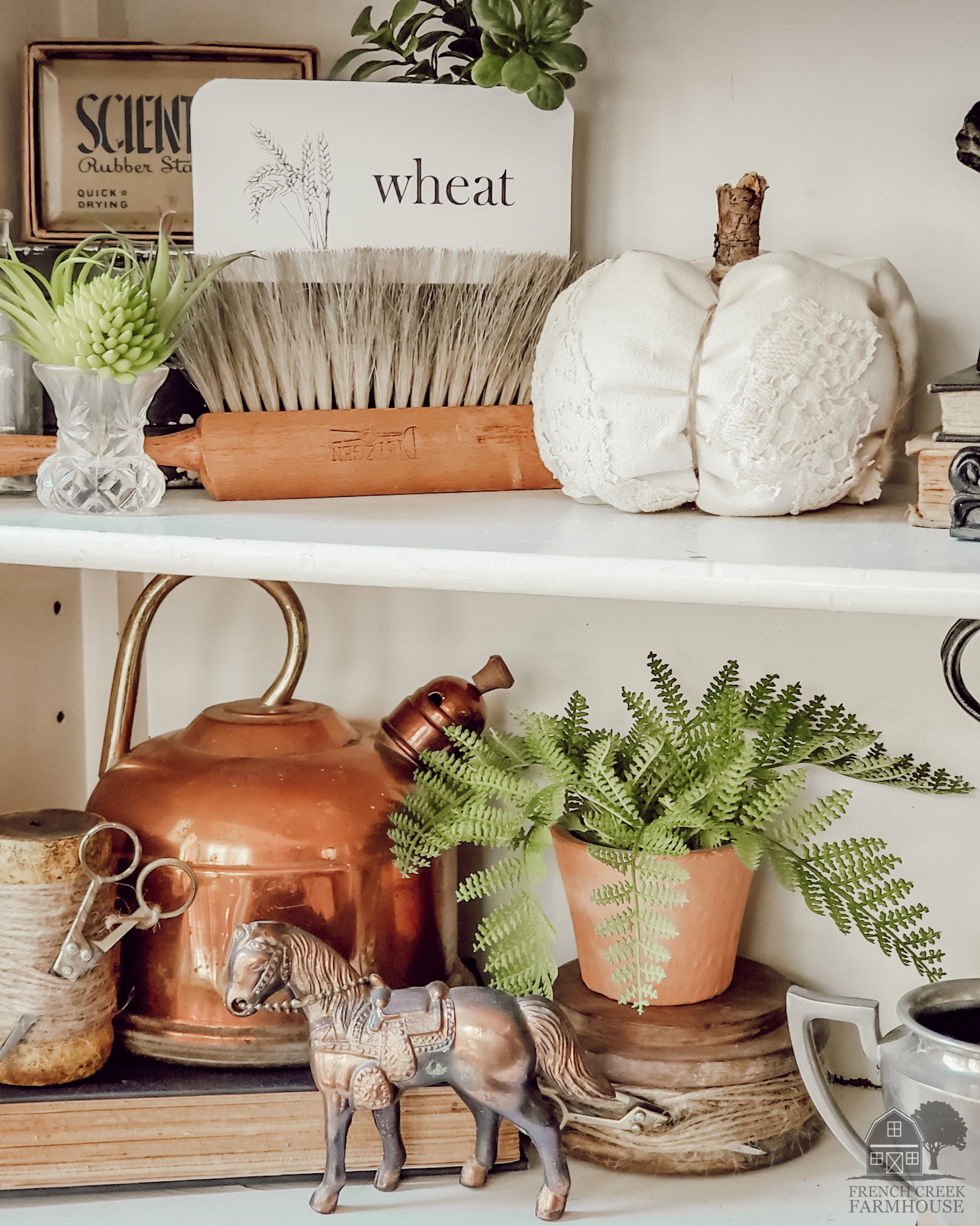 Copper tea kettles and neutral vintage items fill our farmhouse shelves