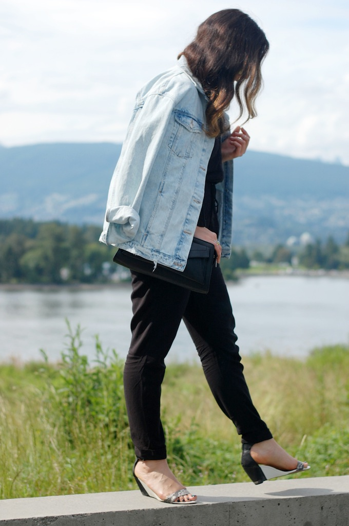 Forever 21 jumpsuit, Zara oversized denim jacket and a Proenza Schouler clutch are combined in the latest outfit post by Vancouver fashion blogger Aleesha Harris of Covet and Acquire.