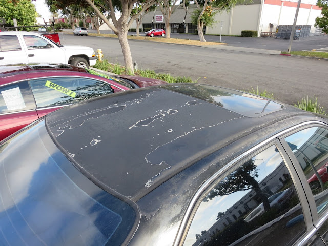 Delaminating (peeling) paint on before complete car paint job.