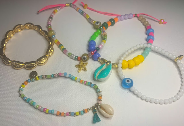 Bracelets and Anklets on White Background