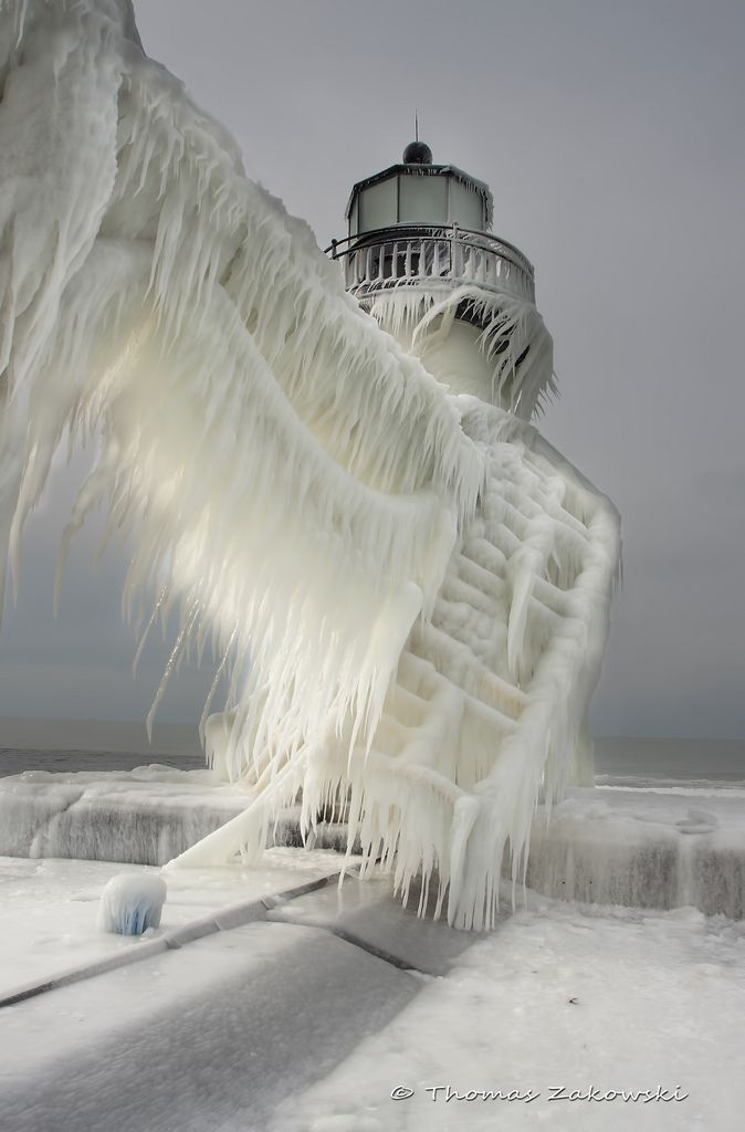 Ice surf covered lighthouse