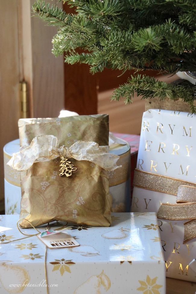 Christmas tree with gold and white gift wrapped packages