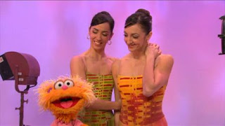 Zoe watches as Lorena and Lorna Feijóo perform their dance. Sesame Street Episode 4325 Porridge Art season 43