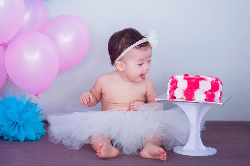 cute angel baby girl see cake