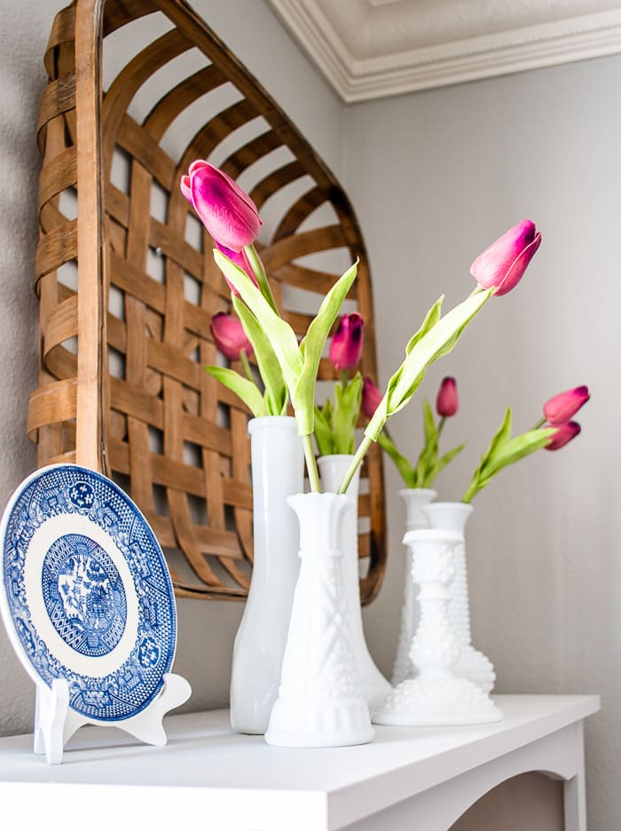 pink tulips in milk glass