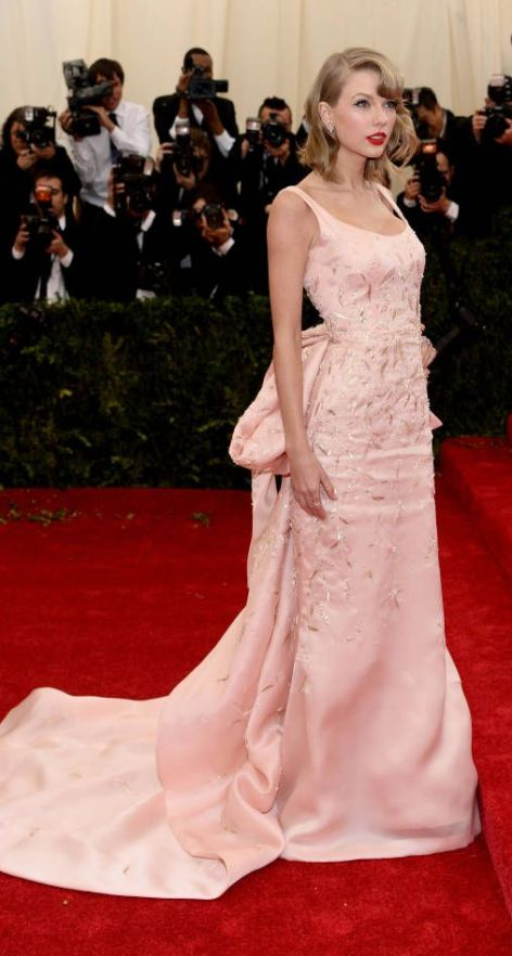 Taylor Swift in a gorgeous pale pink Oscar de la Renta gown at the Met Gala 2014