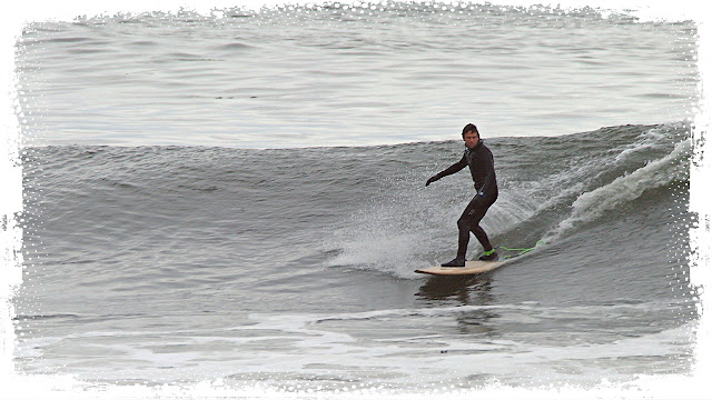 Wet suit surfing...