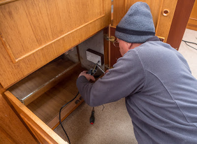 Photo of Phil removing the unused double socket