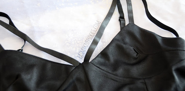 Details on Dresslink's strappy V-neck cropped black bralette top.