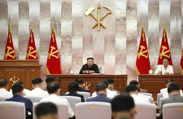 Kim Jong Un at enlarged meeting of Central Military Commission