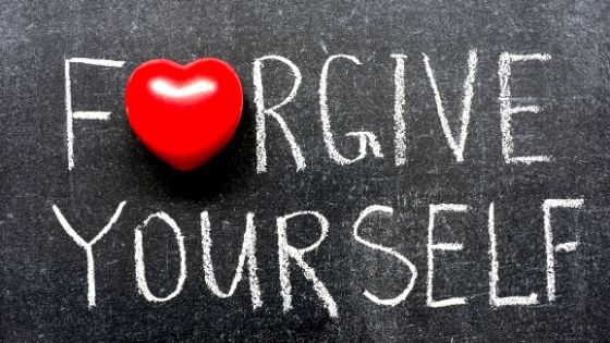 Forgive Yourself written on a chalkboard