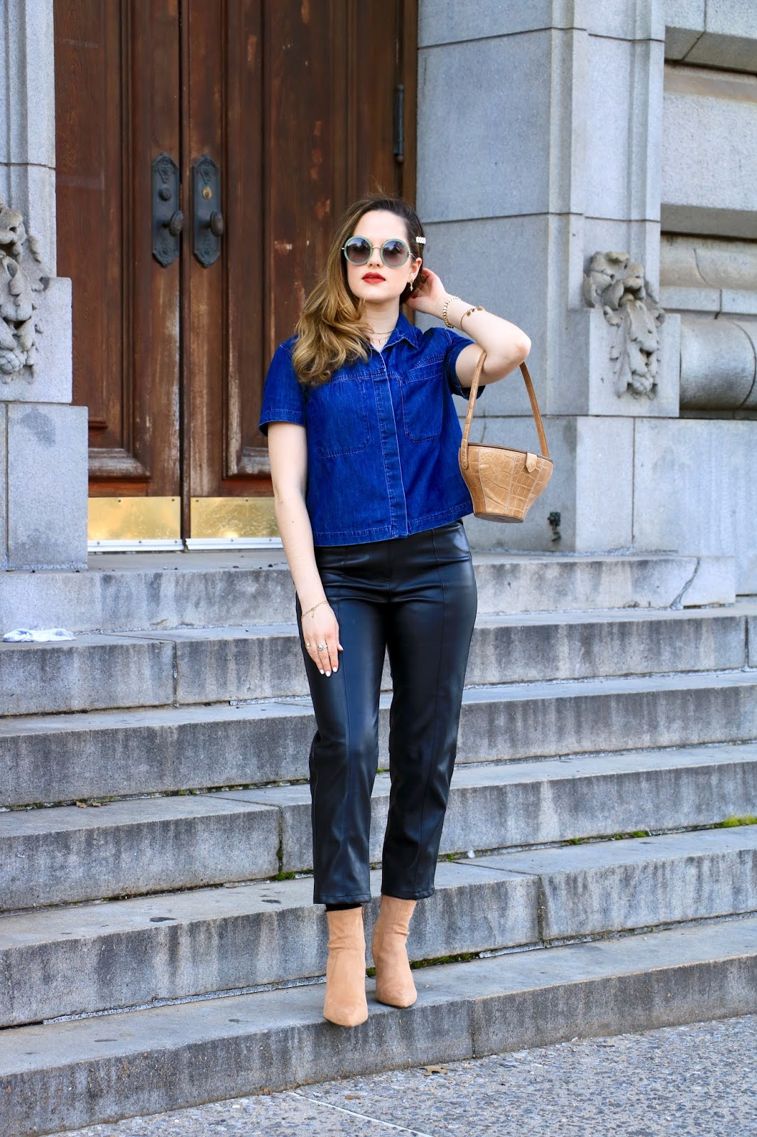 Nyc fashion blogger Kathleen Harper wearing a leather pants outfit in spring.