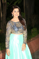 Nikki Galrani in Green Skirt  Top at Marakathamani music launch ~  Exclusive (44).JPG