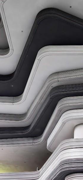 خلفية مبنى الطلبقات الهندسية الاسمنتية رمادية اللون