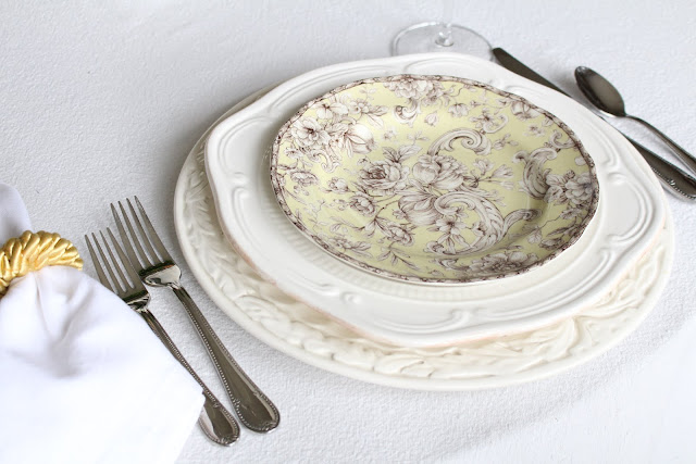 spring floral tablescape green and white toile plates white charger