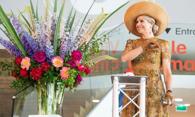 Queen Maxima wore a mustard yellow floral print dress by Zimmermann. Zimmermann Tropicale crinkle dress