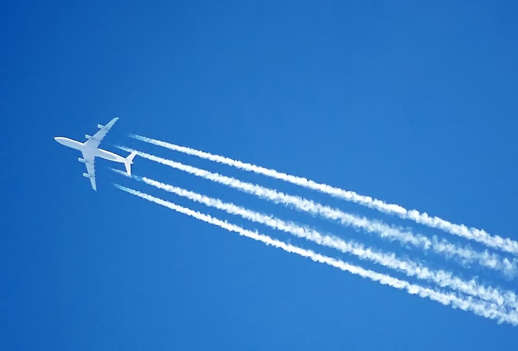 planes leave white trails in the sky